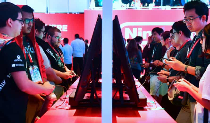 Gamers play Super Smash Bros on the Nintendo Switch at E3 in Los Angeles in June 2018.
