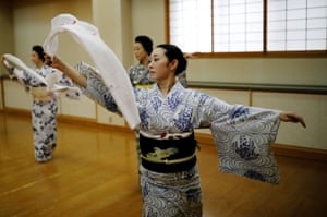 Mayu, Maki and Koiku, who are all geisha, practice a dance routine during a class for geisha only