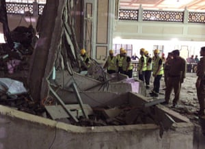 Civil Defence personnel inspect the damage at the Grand Mosque in Mecca.