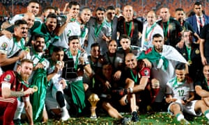 Algeria players and staff celebrate with the trophy in Cairo.