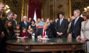 Donald Trump is joined by the congressional leadership and his family as he formally signs his cabinet nominations into law on 20 January 2017.