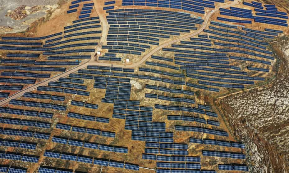 Aerial view of a photovoltaic power generation project on barren hills in Zaozhuang, Shandong Province of China.