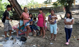 Yukpa women stand near the Francisco Paula de Santander international bridge, which connects Colombia and Venezuela. Unlike other Venezuelan migrants, the indigenous group has been deported twice. Both times, they walked back to Colombia.