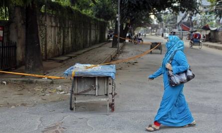 A Bangladeshi woman walks past the site where Cesare Tavella was killed near Dhaka's diplomatic zone.