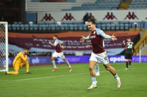 Aston Villa's Jack Grealish celebrates their third deflected goal.