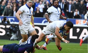 Romain Ntamack goes over to complete a devastating French counter-attack early in the match.
