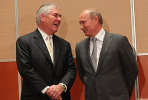 Vladimir Putin (on right) with Trump's secretary of state, ExxonMobil CEO Rex Tillerson.