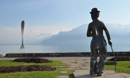 A bronze statue of Charlie Chaplin stares at the Giant Fork in Lake Geneva at Vevey where he lived and died, in Switzerland.
