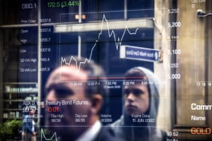 AUSTRALIA-STOCKS-HEALTH-VIRUSPeople are reflected in a window at the Australian Securities Exchange in Sydney on March 17, 202o