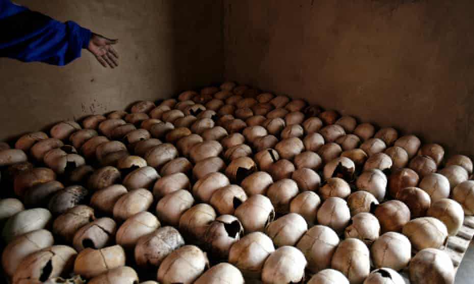 A worker of the Murambi genocide memorial shows the skulls of victims of the 1994 genocide, near Butare, Rwanda.