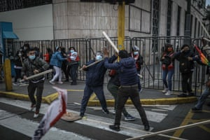 Scuffles break out between supporters of Peru's presidential candidates as the country waits for the result of its disputed election in Lima, Peru
