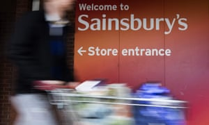 A customer leaves after shopping at a branch of Sainsbury's in London.