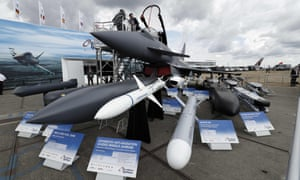 A BAE Typhoon fighter on display at this year's Farnborough airshow, along with a selection of missiles.