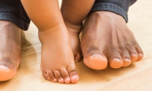 Feet of a father and child