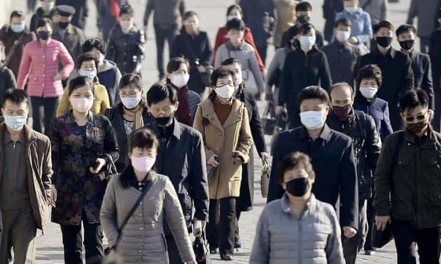 People wearing face masks amid concerns over the coronavirus in Pyongyang, North Korea, in march 2020