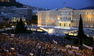 Protesters gather train in front of the parliament during a pro-government rally calling on Greece's European and International Monetary creditors to soften their stance in the cash-for-reforms talks in Athens, June 17, 2015. The Greek central bank warned on Wednesday that the country risked a painful exit from the euro and ultimately even the European Union if Athens and its creditors do not strike a swift aid-for-reforms deal. REUTERS/Yannis Behrakis