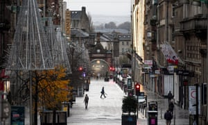 Long shot of a near-deserted street in Glasgow with Christmas decorations