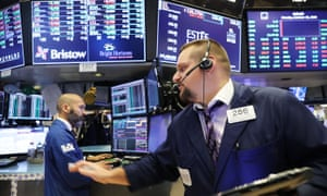 Wall Street closes lower amid fears over trade, oil and