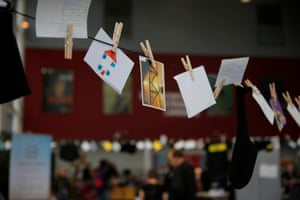 Poems on postcards hang on washing lines at venues across the city