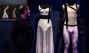 Kevin O'Hare looks at costumes on display at the Design Museum