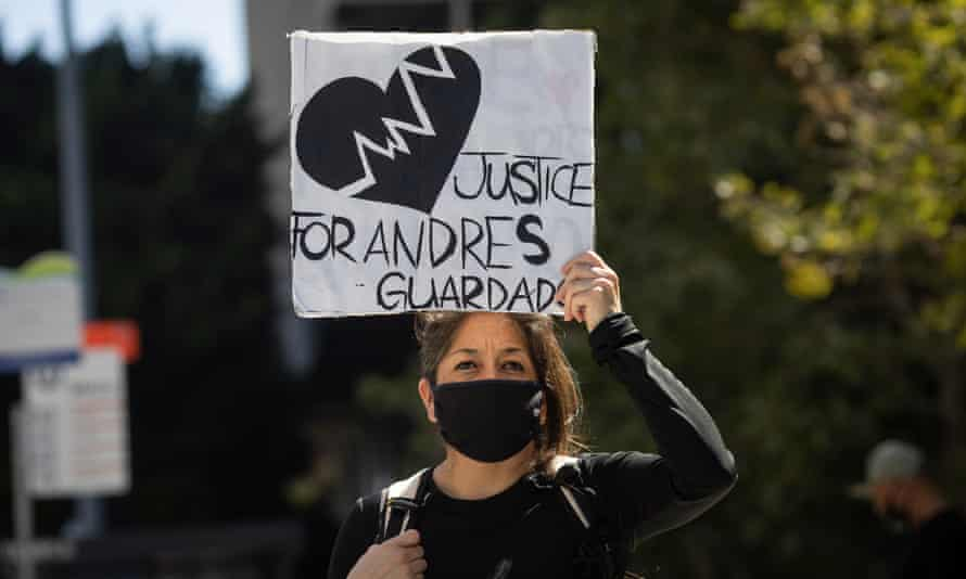 A demonstrator holds a sign demanding justice for Andres Guardado in Los Angeles, California, on 8 July.