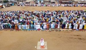 Muslims perform Eid al-Adha prayer in the courtyard of a mosque in Abidjan, Ivory Coast