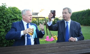 Mike Greene and Nigel Farage have a drink at The Bull public house in Newborough before votes were counted.