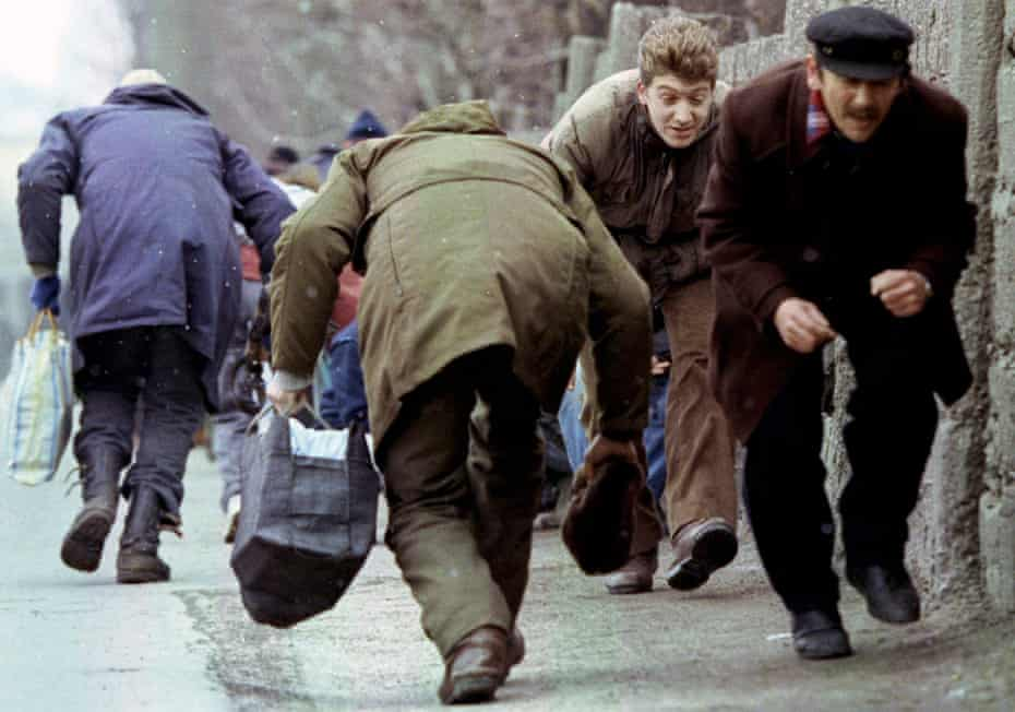 People running for cover from Serbian snipers in Sarajevo in 1993. Ten thousand people were killed during the three-and-a-half-year siege of the city by forces under the command of Ratko Mladic.