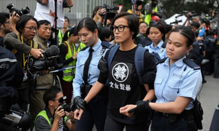 Denise Ho is arrested and escorted by police officers during the clearance of Occupy Central Pro-democracy camp in Hong Kong.