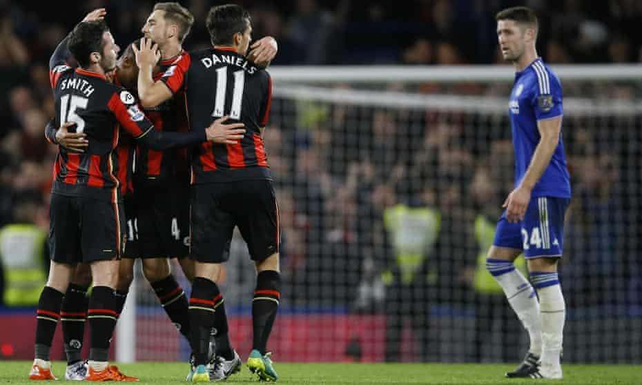 Gary Cahill looks on as the Bournemouth's players celebrate beating Chelsea at Stamford Bridge.