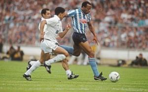 Coventry striker Cyrille Regis surges past Spurs players Osvaldo Ardiles (left) and Chris Hughton.