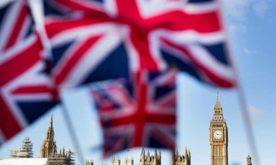Union flags fly in front of the Houses of Parliament in London.