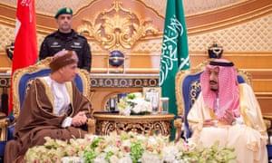 King Salman of Saudi Arabia, right, speaks to Fahd bin Mahmoud al Said, deputy prime minister of Oman