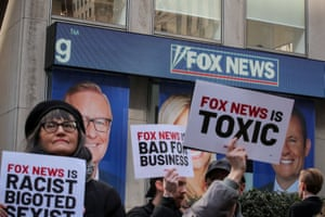 Protesters gather outside of Fox News in New York.