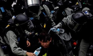 Riot police detain an anti-government protester in Sheung Shui, a border town in Hong Kong