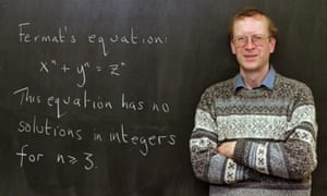 Professor Andrew Wiles poses next to a version of Fermat's equation in 1998.