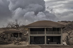 Deserted buildings near the volcano's crater are left covered in ash