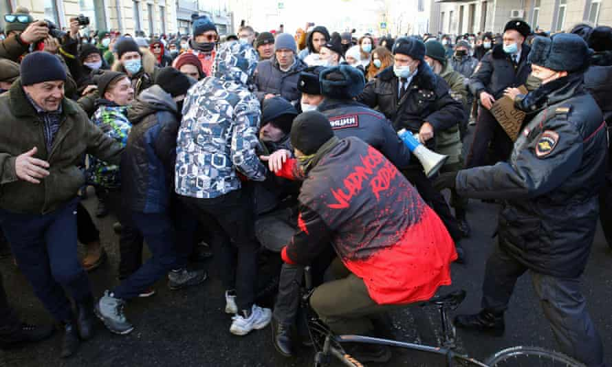 Protesters scuffle with police during a rally in Vladivostok