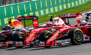 Sebastian Vettel touches his Ferrari team-mate Kimi Raikkonen, who has been squeezed by Max Verstappen at the start of the Belgian Grand Prix