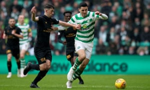 Celtic's Tom Rogic and Livingston's Shaun Byrne battle for possession.
