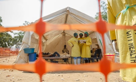 Medical staff give treatment to people suffering from cholera at the medical camp.