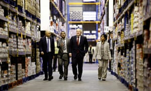 Boris Johnson (second from right) and Sajid Javid (left) with operation managers Kamal Din and Sameena Marland during their visit to Bestway Wholesale in Manchester