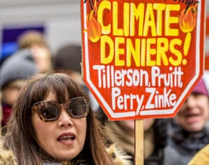 A protest in New York against climate change sceptics in Donald Trump's cabinet.