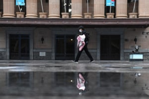 A women walks through Brisbane's King George Square during lockdown.