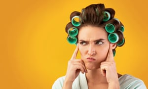 Angry woman frowning, wearing hair rollers