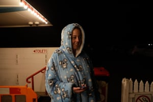Emily Porter rugs up in her dressing gown