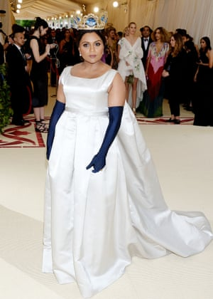 Her silver gown and navy opera-length gloves may have been channeling classic princess style but Mindy Kaling's dramatic gold crown, by Greek jewelry designer Pericles Kondylatos, was all queen.