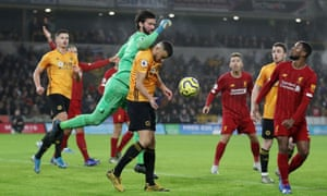 Liverpool's Alisson is fouled by Wolverhampton Wanderers' Romain Saiss.