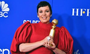 Olivia Colman poses with her Golden Globe award