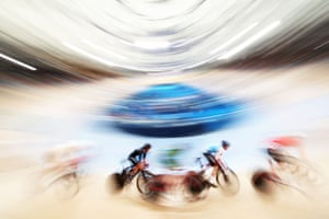 The competitors fly by in the men's 15km scratch race qualifier.